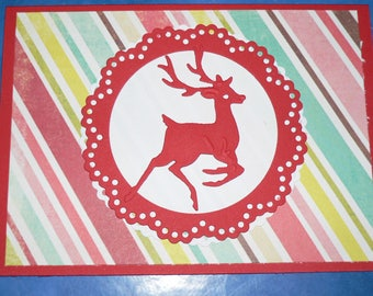Red and colorful reindeer Christmas card