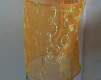 Hanging in lime and orange beads and organza