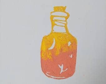 small bottle holding stars print