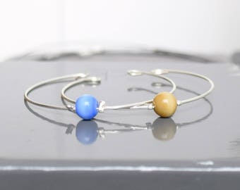 Set of 2 thin metal and Pearl bracelets in the Middle