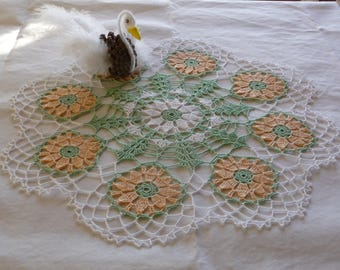 Crochet flower doily handmade white cotton with water and apricot.