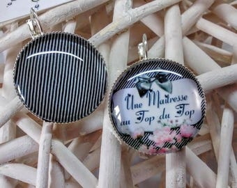 "Earrings ""A teacher at the top of the top"" black & white striped background."
