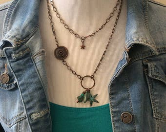 Copper convertable charm necklace with a patina finish.  This necklace can be worn long or, converted to a short necklace.