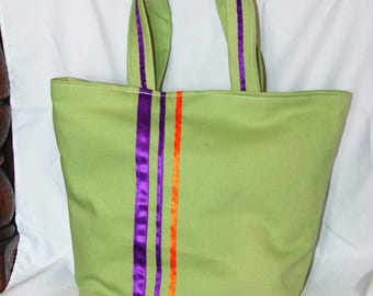 Green tote bag with orange and purple stripes