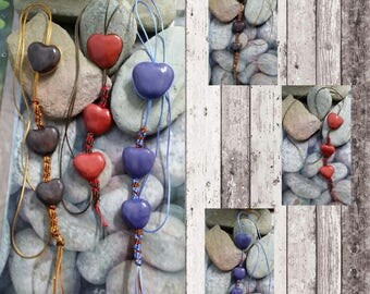 Pendants with 3 hearts glazed clay