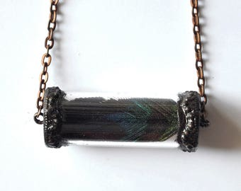 Necklace copper vial with a feather of Peacock on a chain