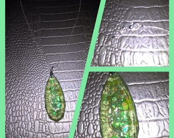 Resin necklace translucent green with inclusions of sequins and silver chain