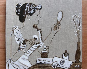 Woman painting on linen mirror
