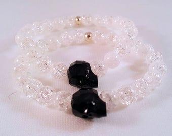 Precious gemstone bracelet made of mountain crystal, Swarovski-crystal skull in black, Silver pearl, elastic band