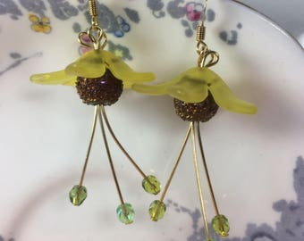Beautiful boho chic gold plated, light yellow lucite harebell earrings with bronze bead centres and drop Swarovski bicones.
