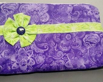 Zippered pouch, ruffled details, flower accent