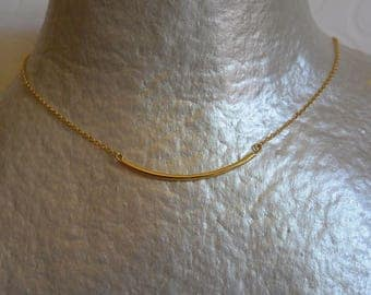 Tube and gold chain necklace
