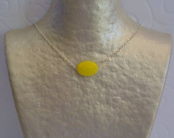 Pillows with yellow collar and silver chain.