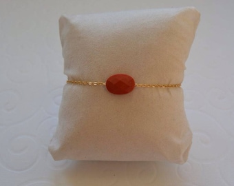 Brick red pillow on gold chain bracelet