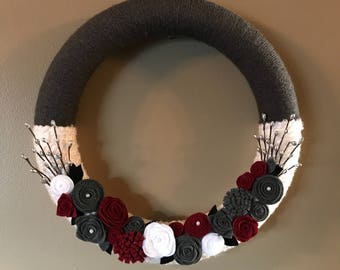 Gray white and red yarn and felt wreath