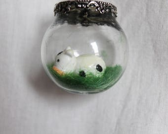 Cow in the meadow in a bubble necklace