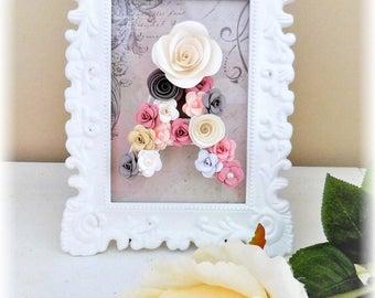 Arabesque frame has decorative letter paper flowers