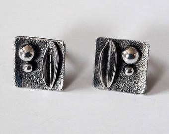 Super beautiful earrings! Silver blacked out. Handmade unique!