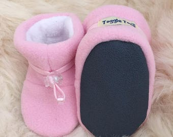 Toggle Toes pink baby slipper, fleece booties, soft sole shoe in infant size 4-12 months, baby shoe size 1-3.5