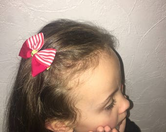 Two hair bow, red and white striped.