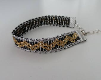 women black, gold and silver braid bracelet