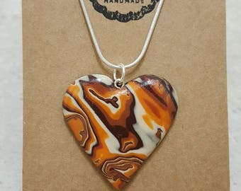 Polymer clay, marbled effect heart necklace.