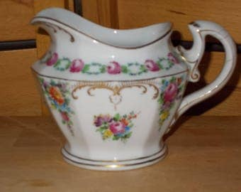 Old milk jug, opulent in décor and style