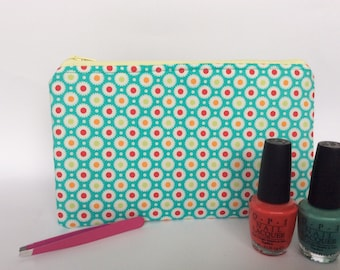 Green makeup or cosmetic bag handmade for women with different colours of dots on it