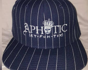 Navy Blue and White Pinstripe Hat with Silver Aphotic Logo on the Front