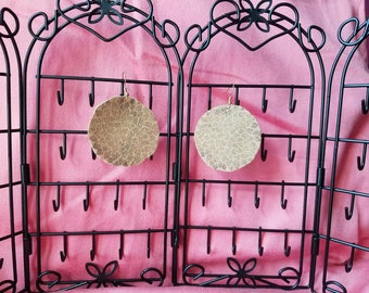Tan leather earring stamped with floral design