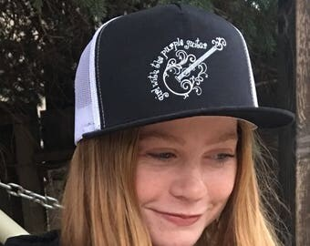 Black canvas trucker hat Girl with the purple guitar logo