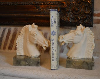 A Vintage pair of bookends. Horse Heads on marble bases signed by sculptor A.Giannelli