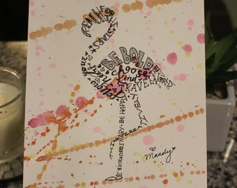 Hand drawn, inspirational word art flamingo on a watercolor splattered background