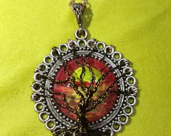 Tree of life pendant with sunset background