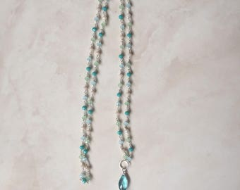 Rosary chain with tassel.