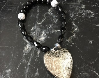 Handmade beaded bracelet in black and silver with heart charm