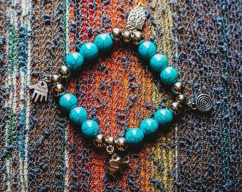 Four charm turquoise bracelet