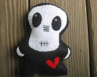 Tiny skull-faced Hoodoo Day of the Dead Doll