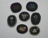 embroidered botanical pins on black linen