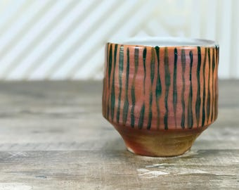Yunomi. Soda fired tea bowl. Soda fired yunomi. Handmade cup with flashing slips. Atmospheric firing. Soda fired teabowl.