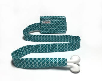 Teal and white TuneTube cord organizer. Earbud cord organizer for iPhone or iPod. Cord keeper. Earbud holder. Earbud case.