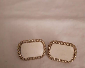 Vintage signed Butler gold and white clip on earrings