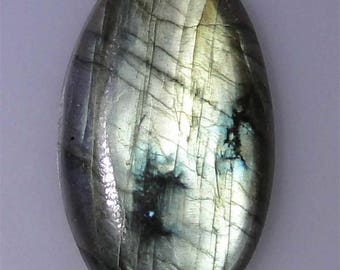 72.57 carat Labradorite oval cabochon, very good or better greenish gold flash. 72.57 cts.   043-10-238