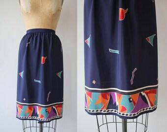 vintage 1980s skirt / 80s silky skirt / 80s border print skirt / 80s navy geometric skirt / size small 25 inch waist