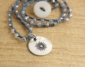 Crocheted Necklace with an Indigo Blue Cord, Tiny, Crystal AB Beads and a Round, PMC Pendant with a Sun Design SN-353