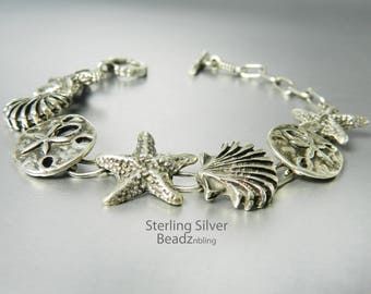 Vintage Sterling Silver Seashell Bracelet Sea Life Charm Bracelet Starfish Sand Dollar Scallop Shell Toggle Clasp