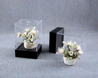 Light Yellow  flower arrangement in a wicker basket all inside an acrylic showcase box