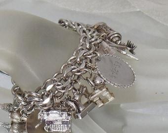 SALE Vintage 1950s Sterling Silver Charm Bracelet. 25 Charms.  Souvenir International Silver Charm Bracelet.  Triple Link Charm Bracelet.