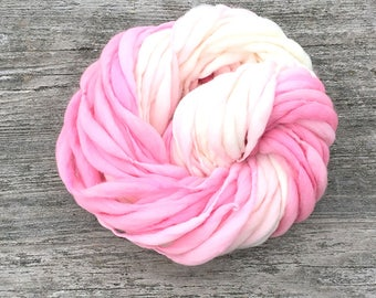 Handspun yarn, rose to cream ombre, 50 yards and 3.25 ounces/ 92 grams, thick and thin in merino wool