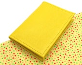 Yellow leather Oystercard holder, spot lining